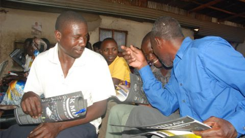 UW Photo: knowledge is power! residents of Masaka and Rwengo districts reading the Black Monday magazines