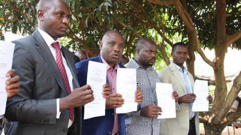 UW Photo: kampala Erias Lukwago and LCIII Councilors display the court order