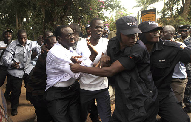 Ugandan policemen arrest opposition leader Kizza Besigye in 2012 James Akena / Reuters