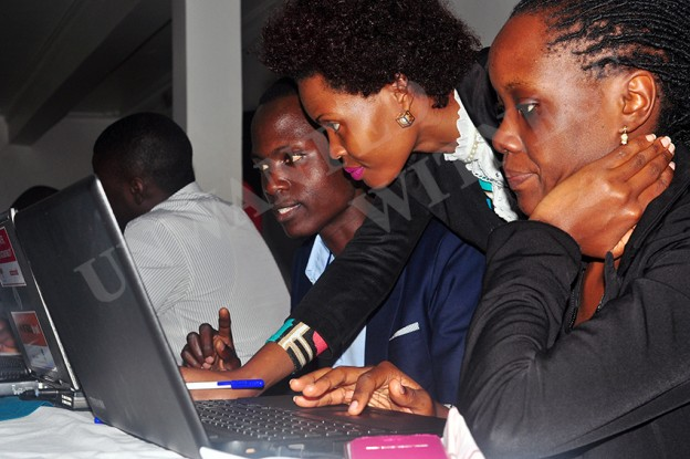 A lady powered trainer helping out participant's during one of UW's trainings aimed at empowering Women in ICT.