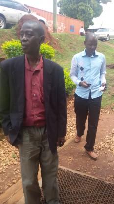 Rwomushana (back) and his lawyer Yunus kasirivu