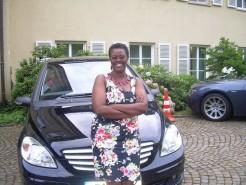 Muhanga-standing-by-her-posh-ride