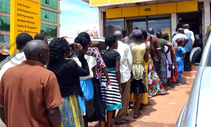 Some of the Ugandans seen struggling to register their sim cards at MTN service centres.